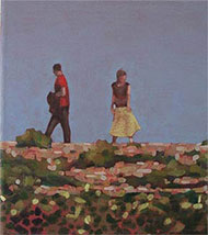 A couple walking on a hot summers day at Dungeness