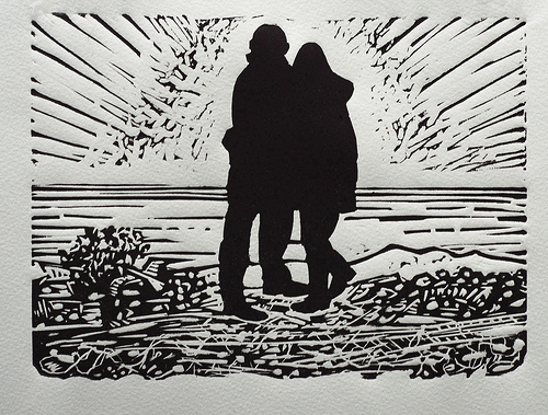 Couple on the beach at Dungeness